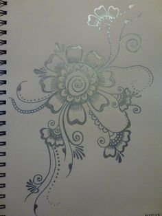 Incorporates flowers and vines. Used a metallic blue pen. Size is A4