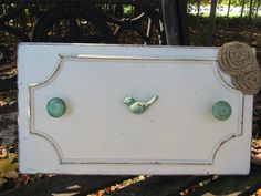 Cost rack, towel rack, jewelry hanger, bow hanger on repurposed shabby chic wood with decorative knobs