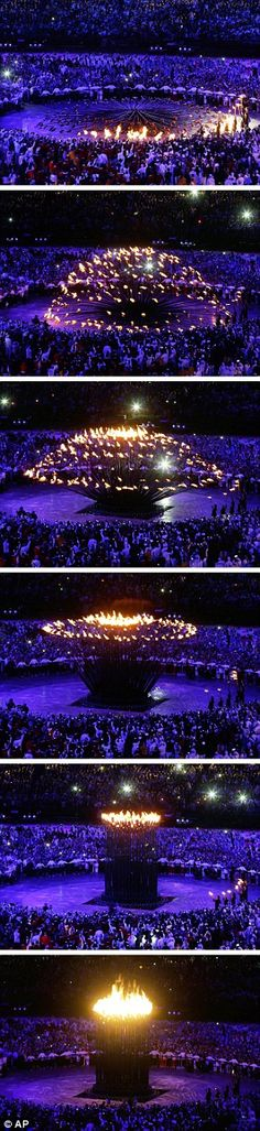 Best cauldron ever! 204 copper and steel petals of the Olympic cauldron being lit before being lifted up to form one giant flame designed by Thomas Heatherwick