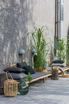 Simple and cool daybeds on the terrace creates a cosy atmosphere. To get a zen mood, stones and lanterns are placed near the daybeds, which turn on when darkness falls on.