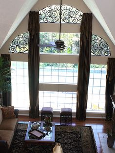 Metropolis Iron can create the custom window inserts and the drapery hardware to match.  Great design work on this window treatment.  www.metroiron.net