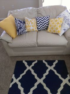 navy and yellow pillows :) love the rug too!
