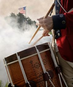 American drummer playing in foreground, in the smokey distance a Continental soldier is on guard next to the American Flag. Shot at Yorktown Battlefield, photo by David M. American Revolutionary War, American War, Early American, American History, Yorktown Battlefield, A Lovely Journey, Seven Years' War, War Of 1812, Drummer Boy