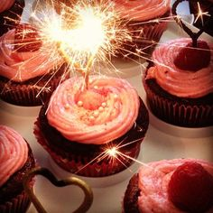 Raspberry Chocolate ganache filled cupcakes with heart-shaped sparklers