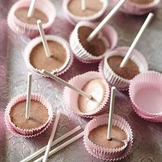 Mini Frozen Mousse Pops  3/4   cup whippping cream   3   ounces bittersweet or semisweet chocolate, finely chopped   1   tablespoon unsalted butter   1/2   cup whole milk   2   egg yolks   4   tablespoons sugar    1   tablespoon cornstarch       Pinch salt