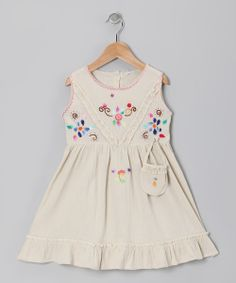 Handmade in the valleys of Ecuador, this breezy frock features handy pockets, back tagua nut buttons and a ruffle hem that make it extra special. Every flower is hand-stitched with variegated thread, making each blossom one of a kind. 100% cottonMachine wash; tumble dryMade in Ecuador