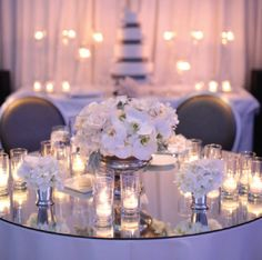 Mirrored table top, candles and orchid centerpiece, alexanevents.com
