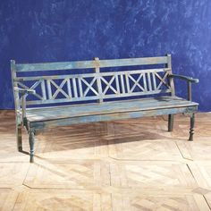 Vintage Blue Bench - This piece was probably reclaimed from an old Indian school in Rajasthan. Made of teak, this bench dates back to the mid-1900s, evidenced by its distressed, painted finish. It has the slightest resemblance of antique British Colonial furnishings, with features like turned-wood legs and austere shape.