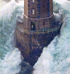 Lighthouse of the coast of France and yes that is a man in the door way.  He survived the waves and was rescued in 1989.