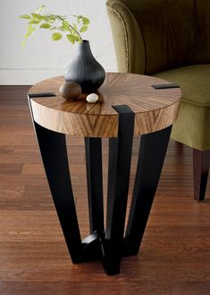 Compass Side Table by Enrico Konig. This elegant tables unique appeal comes from the striking contrast of ebonized hardwood legs, perfectly constructed to support and break through its beautifully figured and radially matched curly French walnut top. Please note: This item ships from Canada and can only be shipped Ground service.