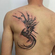 black and gray phoenix tattoo on back by Rodrigo MUNDINS