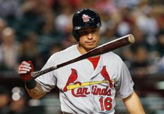 St. Louis Cardinals' Kolten Wong tosses his bat in the air after striking out against the Arizona Diamondbacks during the ninth inning of a baseball game Saturday, Sept. 27, 2014, in Phoenix. The Diamondbacks won 5-2. (AP Photo/Ross D. Franklin)