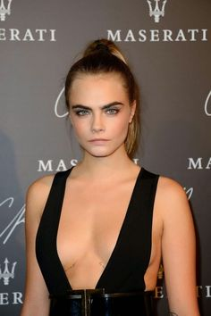 Cara Delevingne leaves little to the imagination in a revealing jumpsuit at the CR Fashion Book #5 Paris Launch Party