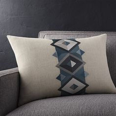 Natural nubby linen pillow is banded in a diamonds rendered in jewel-toned, blue embroidery. Pillow reverses to solid natural. Our decorative pillows include your choice of a plush feather-down or lofty down-alternative insert at no extra cost.