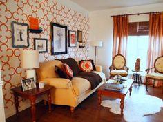 Quatrefoil paper or stencil on wall, orange accents.