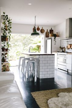 Take a tour of this sleek, yet bohemian, home to get inspiration for your next remodel. The rustic accents contrast beautifully with the modern kitchen tile and appliances.