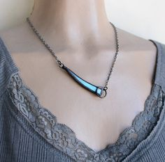 Reserved Listing - OOAK Asymmetrical Blue Iridescent Necklace - Stained Glass Jewelry  Handmade by me. This is a brand new design and is my original work. This is a gorgeous one-of-a-kind asymmetrical design made with a light blue iridescent glass reflecting blues and purples It has a hand polished gunmetal finish and comes ready to wear with a total length of 18.50 including the gunmetal chain The pendant measures 5/8 x 2.50 As with all my jewelry, it is lead-free and safe to wear.