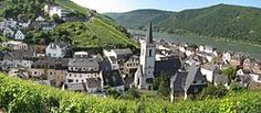 MIDDLE RHINE: Assmannshausen is located on the Rhine in the state of Hesse, Germany. The village has a lithium spring, spa and a Kurhaus, and is famed for its red wine.  There is castle after castle: Rheinstein, Reichensten, Sonneck, Hainburg, Lorch, ruins of Nollich, Lorchausen.