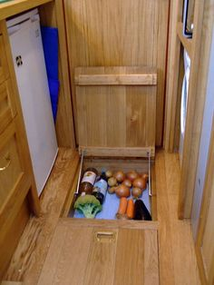 cool underfloor storage for veggies etc. similar idea to the underfloor fridge idea - To connect with us, and our community of people from around the world, learning how to live large in small places, visit us at www.Facebook.com/TinyHousesAustralia