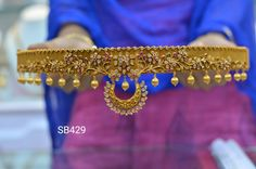 Beautiful waist belt having chaandbali hanging at the center. Vadanam with floret lata design. Vadanam studded with multi color stones. vadanam with pumpkin hangings. 28 January 2018
