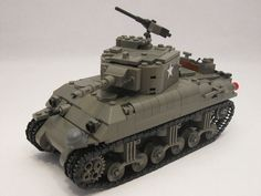 """One of the projects in my Lego Military Bucket List was to eventually redesign my 5 Old Dark Grey Shermans. What started out as several """"small"""" changes resulted in an almost complete rebuild from the wheels up. My Shermans were originally heav Hey la Lego Ww2, Lego Army, Lego Kits, Lego Boards, Amazing Lego Creations, Sherman Tank, Star Wars Pictures, Custom Lego, Lego Technic"""