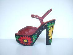 Vintage 1970s wooden platform leather shoes.