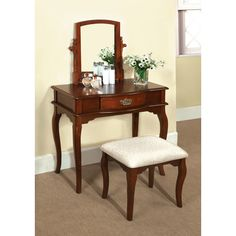Features:  -Includes vanity table with matching stool.  -Material: Solid wood.  Product Type: -Vanity set.  Style: -Traditional.  Number of Items Included: -3.  Mirror: -Yes.  Drawers Included: -Yes.