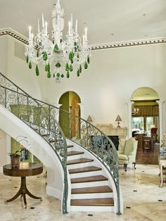 I love this giant chandelier with big green drops of crystal! #design #decor