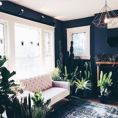 The dark navy walls in this room really contract the space. Decoration Inspiration, Room Inspiration, Interior Inspiration, Home Interior Design, Interior And Exterior, Living Spaces, Living Room, Design Seeds, Amazing Spaces