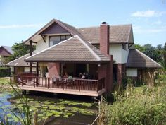 Situated on the Fairway of Selborne Park Golf Estate, Cherry Lodge is a gorgeous 3 bedroom, 3 en-suite bathroom, self-catering villa guest house with breath-taking views, especially magnificent at Sunset! Golf Holidays, Golf Estate, Holiday Accommodation, Catering, Cherry, Villa, Cabin, Sunset, Park