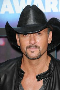 tim mcgraw - terrible, TERRIBLE dresser... like a cowboy chippendale but YES!