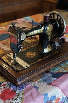 singer sewing machine my grandmother had one almost like it! :)