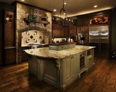Old World Tuscan Kitchens | The Kitchen Dahab-love the stone arch,backsplash,light,appliances,flooring,island,colors of cabinetry