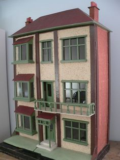 Rare antique dolls house with original wallpapers and flooring - with history