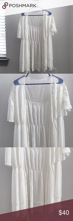 Zara white Dress I purchased this from Zara Europe a couple of years ago. It is a dress however my intended use was as swimsuit coverup at the beach. Since then I actually never ended up wearing it, hence why I'm selling. It's absolutely beautiful white lace and chiffon, with belt to tie for a perfect fit. There are some small stains that I found while I was taking picutures, I have no idea what it's from or how it got there but just to be aware of it. Zara Swim Coverups