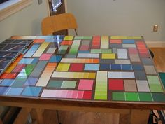 #Paintchip mosaic done under a glass top on a work table perhaps in your home office or craft room!