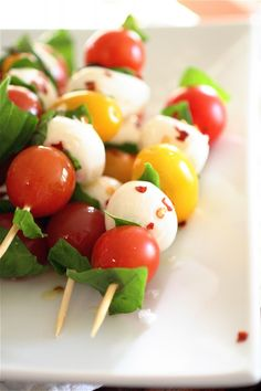 Caprese Skewers:  Ingredients:*1 pint cherry tomatoes*1 pint yellow tomatoes*1 pound fresh ciliegine or other type of mozzarella cheese, fresh*1 cup fresh basil leaves, gently torn into 1/2-inch pieces*Pinch red pepper flakes, to taste*Sea salt, to taste*Extra-virgin olive oil, for drizzling*Wooden skewers, for serving