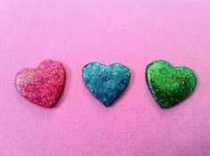 three supper glitter resin heart cabochons/pins