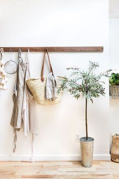 Faux Olive Tree DIY - how to make this pretty tree using faux materials. Budget friendly and quick/easy project for any style decor!