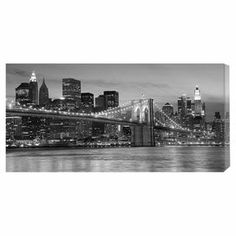 "Hang this artful canvas above your living room seating group to create a stylish conversation space, or display it in the for an eye-catching focal point. Crafted in the USA, this chic design showcases a night scene of the Brooklyn Bridge.  Product: Canvas printConstruction Material: Wood and CanvasFeatures:  Made in the USAReady to hang'Brooklyn Bridge at Night' Dimensions: 18"" H x 36"" W x 1.5"" D"