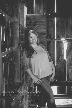 Senior girl in old barn