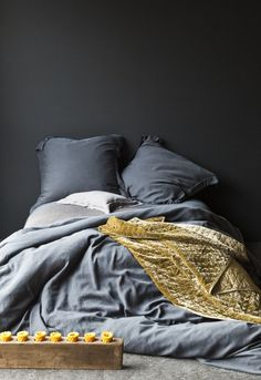 dark grey and gold- this is the kind of messy, undone sort of bed I could totally keep up with.