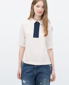 TOP WITH ZIP ON CHEST