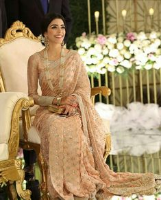 Sari (read Saree), has been around since long, and it is on the top priority list of many women. This attire is commonly worn in India. Pakistani Formal Dresses, Pakistani Outfits, Indian Dresses, Indian Outfits, Indian Clothes, Pakistani Clothing, Engagement Saree, Peach Saree, Saree Look