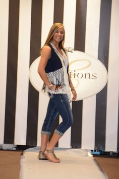 Jess is rocking the demin trend with this Miss Me fringe vest, Big Star capri's and Karen Kane lace top.