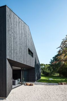 Dutch studio FillieVerhoeven Architects has completed a house near Rotterdam featuring an asymmetric gabled form clad entirely in blackened timber.