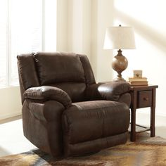 The Sabel rocker recliner from Ashley sofa will add comfort and style to your home. Upholstered in smooth brown faux leather fabric, this padded lounger offers swivel, rocker and fully reclining functions for the ultimate in relaxation.