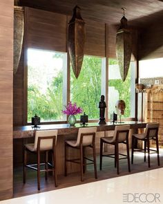 The brass hanging lanterns in the bar are by Jalan Jalan Collection, cool global furniture store in Miami design district