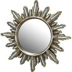 Accent your entryway or add an eye-catching touch to the den with this Art Deco-inspired wall mirror, showcasing a sunburst design and distressed silver fini...