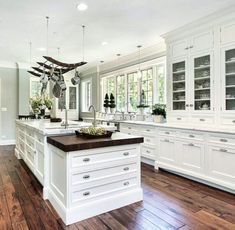 Lovely White Kitchen along with darker wood flooring